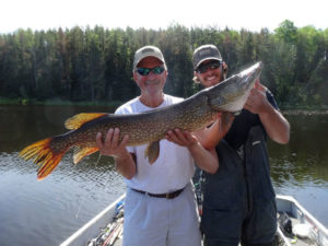 "Glenn Heseman shows off a very nice 41"" northern Pike caught on a recent trip to Sabourin Lake in Ontario using a Loomis rod and Shimano Curado 300E reel. We think Glenn's smile says it all!"