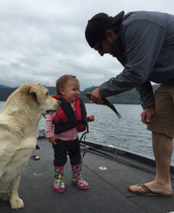 We don't know about you, but to us it just doesn't get any better than kids, dogs, and fishing. Thanks to Gary Dobyn's son Richard for this marvelous picture of his daughter and her very first fishing trip!